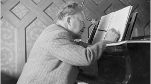 Peterson-Berger at his grand piano.
